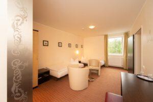 Familienzimmer mit Wohnbereich - Bergwirtschaft Wilder Mann (bei Dresden)